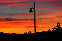 The sunrises in the Flathead Valley in Montana. A streetlamp watches.