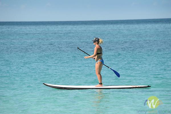 Cinnamon Bay Beach, Virgin Islands National Park. Young woman paddle boarding.