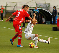 TUNJA - COLOMBIA -22 -03-2014: Leandro Pico (Izq.) jugador de Patriotas FC disputan el balón con Daniel Santa (Der.) jugador de Alianza Petrolera, durante partido por la fecha 12 de la Liga Postobon I-2014, jugado en el estadio La Independencia de la ciudad de Tunja. / Leandro Pico (L) player of Patriotas FC vies for the ball with Daniel Santa (R) player of Alianza Petrolera, during a match for the date 12th of the Liga Postobon I-2014 at the La Independencia  stadium in Tunja city, Photo: VizzorImage  / Jose M. Palencia / Str. (Best quality available)