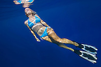 Woman free diving, Kealakekua Bay, Big Island, Hawaii, Pacific Ocean.