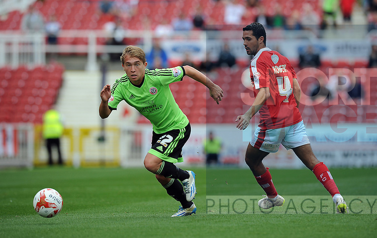 Louis Reed of Sheffield United is challenged by Fabien Robert of Swindon Town<br /> - English League One - Swindon Town vs Sheffield Utd - County Ground Stadium - Swindon - England - 29th August 2015