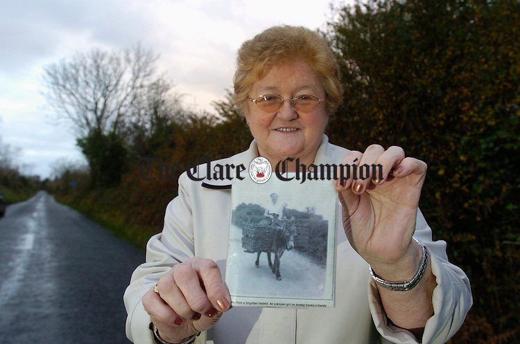 Maureen Bermingham nee Byrnes, standing on location with a copy of the picture taken when she was seventeen in August 1957 near her family home outside Ballyvaughan. Photograph by John Kelly.