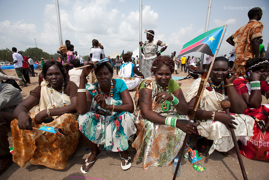 Saturday 9 july 2011 - Juba, Republic of South Sudan - South Sudanese women hold the flag of their new country during celebrations marking South Sudan's independence in Juba as it seceded from the north and became the world's newest nation. Tens of thousands of citizens of the new South Sudan celebrate national independence but whether statehood will resolve issues of identity after a decades-long war remains to be seen. Photo credit: Benedicte Desrus