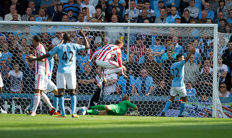 Stoke City's Peter Crouch scores the opening goal as Manchester City's Gael Clichy appeals unsuccessfully for handball by the Stoke forward..Football - Barclays Premiership - Stoke City v Manchester City - Saturday 15th September 2012 - Britannia Stadium - Stoke..