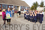 WHO WANTS TO WIN A HEIFER: The parents council at Ballincrossig national school are planning to raffle a heifer to raise funds for the school. Pictured were: Principal Diane Crean and Dan O'Mahoney (Chairman of Parents Council) and teachers, staff and pupils from the school.