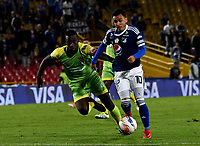 BOGOTA - COLOMBIA - 25 – 03 - 2018: Santiago Montoya (Der.) jugador de Millonarios disputa el balón con Ramon Cordoba (Izq.) jugador de Jaguares F. C., durante partido de la fecha 10 entre Millonarios y por la Liga Aguila I 2018, jugado en el estadio Nemesio Camacho El Campin de la ciudad de Bogota. / Santiago Montoya (R) player of Millonarios vies for the ball with Ramon Cordoba (L) player of Jaguares F. C., during a match of the 10th date between Millonarios and Jaguares F. C., for the Liga Aguila I 2018 played at the Nemesio Camacho El Campin Stadium in Bogota city, Photo: VizzorImage / Luis Ramirez / Staff.
