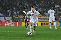 England's James Milner dribbles into the attack in his team's match with the U.S. in their debut match of the 2010 FIFA World Cup. The U.S. and England played to a 1-1 draw in the opening match of Group C play at Rustenburg's Royal Bafokeng Stadium, Saturday, June 12th.