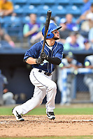 Asheville Tourists center fielder Matt Hearn (1) swings at a pitch during game one of a double header against the Columbia Fireflies at McCormick Field on August 4, 2018 in Asheville, North Carolina. The Tourists defeated the Fireflies 5-1. (Tony Farlow/Four Seam Images)