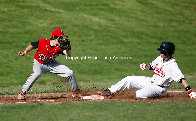 Southbury, CT-04 April 2012-050412CM02-  Pomperaug's Matt Paola slides safely into third as Masuk's Anthony Amoroso can't make the tag in time Friday afternoon in Southbury.  Pomperaug won, 5-2.     Christopher Massa Republican-American
