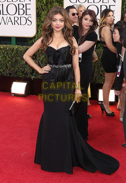 Sarah Hyland.70th Annual Golden Globe Awards held at the Beverly Hilton Hotel, Hollywood, California, USA..January 13th, 2013.globes full length black strapless dress peplum hand on hip clutch bag cleavage .CAP/ADM/SLP/COL.©Collin/Starlitepics/AdMedia/Capital Pictures.