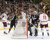 Kevin Hayes (BC - 12), Destry Straight (BC - 17) and Chris Kreider (BC - 19) celebrate Straight's goal. - The Boston College Eagles defeated the Providence College Friars 4-2 in their Hockey East semi-final on Friday, March 16, 2012, at TD Garden in Boston, Massachusetts.