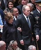 Former United States President George W. Bush and former first lady Laura Bush arrive for the National funeral service in honor of the late former US President George H.W. Bush at the Washington National Cathedral in Washington, DC on Wednesday, December 5, 2018.<br /> Credit: Ron Sachs / CNP<br /> (RESTRICTION: NO New York or New Jersey Newspapers or newspapers within a 75 mile radius of New York City)