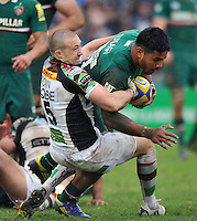 Mike Brown tackles Manu Tuilagi. Aviva Premiership semi final, between Leicester Tigers and Harlequins on May 11, 2013 at Welford Road in Leicester, England. Photo by: Patrick Khachfe / Onside Images