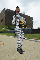 Washington  DC, June 22, 2017, USA: A member of PETA (People for the Ethical Treatment of Animals) is dressed as a Zebra in body paint to protest a circus coming to the Washington DC area.  Patsy Lynch/MediaPunch