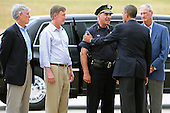 United States President Barack Obama (2nd R) is greeted by (L-R) U.S. Senator Mark Udall (Democrat of Colorado), Governor John Hickenlooper of Colorado, Aurora Police Chief Dan Oates and Aurora Mayor Steve Hogan after arriving at Buckley Air Force Base July 22, 2012 in Aurora, Colorado. Obama traveled to the University of Colorado Hospital to meet with victims of last Friday's movie theater mass shooting. Police in Aurora, a suburb of Denver, say that James Holmes, 24, in custody after he is suspected of killing 12 people and injuring 59 during a midnight screening of 'The Dark Knight Rises' last Friday. .Credit: Chip Somodevilla / Pool via CNP