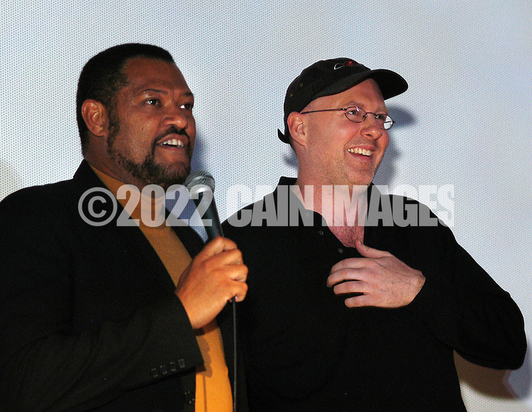 """PHILADELPHIA - MARCH 30:  Actor Laurence Fishburne (L) and Director Doug Atchison introduce their film """"Akeelah and the Bee"""" at the opening of the 2006 Philadelphia Film Festival March 30, 2006 in Philadelphia, Pennsylvania. The festival runs through April 11, 2006. (Photo by William Thomas Cain/Getty Images)"""