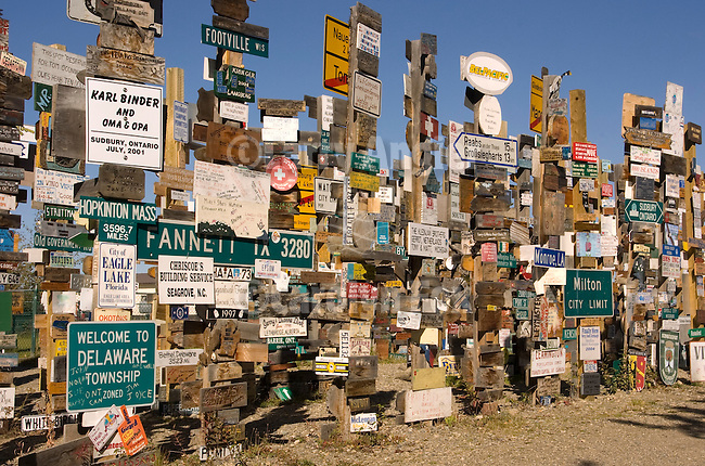 The Alaska Highway Sign Post Forest started during the construction of the Alcan Highway in 1942. It now has more than 60,000 signs, most placed since 1988 when 6281 signs were counted. Included amongst the signs are hand-made signs, hub caps, tires, license plates, street signs, and custom-made signs.