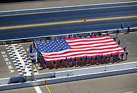 Jul 30, 2017; Sonoma, CA, USA; Overall view of an American flag during the national anthem prior to the NHRA Sonoma Nationals at Sonoma Raceway. Mandatory Credit: Mark J. Rebilas-USA TODAY Sports