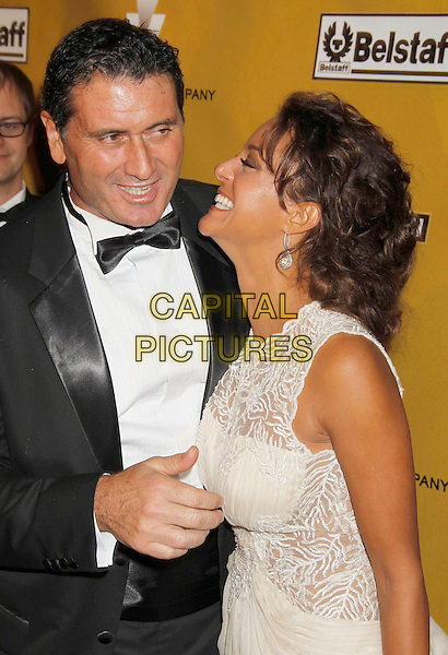 JOE CAPPUCCIO & EVA LaRUE .Weinstein Company Post Golden Globe Party held at Bar210 & Plush Ultra Lounge at the Beverly Hilton Hotel, Beverly Hills, California, USA..January 17th, 2009.globes half length white cream beige sleeveless dress black tuxedo jacket shirt couple la rue laughing profile mouth open pattern .CAP/ADM/MJ.©Michael Jade/Admedia/Capital Pictures