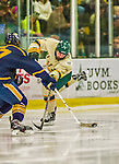 29 December 2013:  University of Vermont Catamount Forward Tom Forgione, a Freshman from South Burlington, VT, takes a shot in the second period against the Canisius College Golden Griffins at Gutterson Fieldhouse in Burlington, Vermont. The Catamounts defeated the Golden Griffins 6-2 to capture the 2013 Sheraton/TD Bank Catamount Cup NCAA Hockey Tournament for the second straight year. Mandatory Credit: Ed Wolfstein Photo *** RAW (NEF) Image File Available ***
