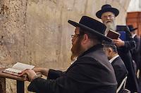 Israel,Jerusalem, orhodox judes men pray in Wilson's Arch, beside the Western Wall