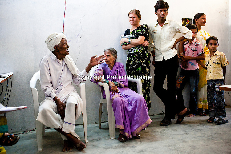 Villagers wait for their turn at the enrollment centre in Naagaaram village, outskirts of Hyderabad in Andhra Pradesh, India. India is assigning each one of its 1.2 billion people a unique ID number based on digital finger prints and iris scan. Photograph: Sanjit Das/Panos