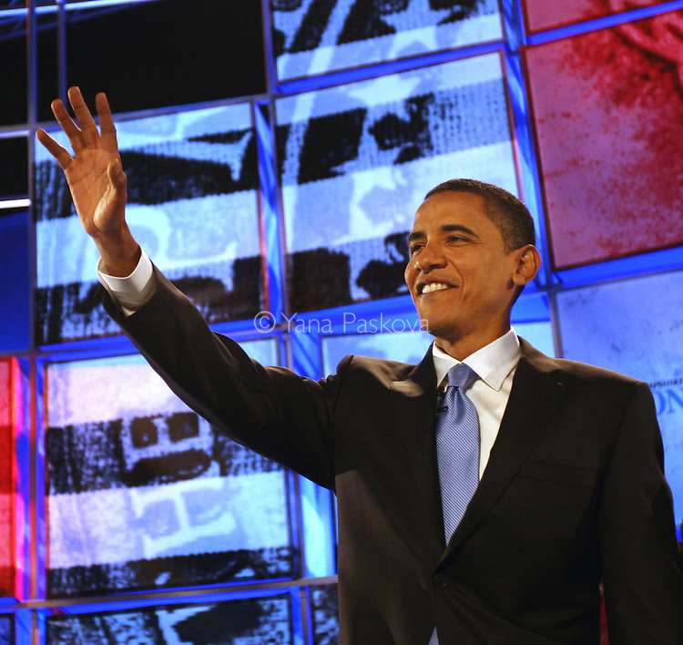 Democratic presidential candidate Sen. Barack Obama (D-IL) waves to the audience from the stage before the democratic debate at St. Anselm College on June 3, 2007, in Manchester, New Hampshire. The debate's sponsors include CNN, Hearst Argyle's WMUR-TV and the New Hampshire Union Leader. The Republican candidates' debate is scheduled on June 5, 2007.