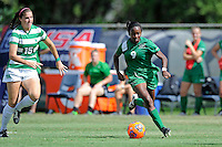 8 November 2015:  Marshall Forward Sydney Arnold (9) advances the ball with North Texas Midfield Alexsis Cable (15) in pursuit in the first half as the University of North Texas Mean Green defeated the Marshall University Thundering Herd, 1-0, in the Conference USA championship game at University Park Stadium in Miami, Florida.