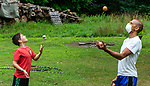 HARWINTON , CT-080620JS08—Leander Gemino, 11, of Harwinton, left, practices his juggling skills with instructor Joel Melendez during the Thrive Movement Studio's circus camp Thursday at their studio in Harwinton. <br />  Jim Shannon Republican-American