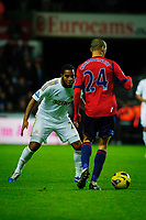 Sunday, 28 November 2012<br /> Pictured:(L-R) Kemy Agustien and Peter Odemwingie.<br /> Re: Barclays Premier League, Swansea City FC v West Bromwich Albion at the Liberty Stadium, south Wales.