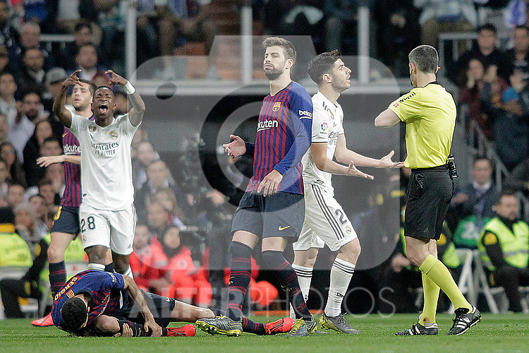 Referee Undiano Mallenci shows yellow card to Real Madrid CF's Marco Asensio  during La Liga match. March 02,2019. (ALTERPHOTOS/Alconada)