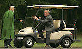 Camp David, MD - August 5, 2007 -- United States President George W. Bush gets ready to give President Hamid Karzai of Afghanistan a ride at Camp David, Maryland on Sunday, August 5, 2007..Credit: Dennis Brack - Pool via CNP