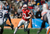 01 January 2007: Nebraska quarterback Zac Taylor (#13) dodges Auburn defenders on the run during the 2007 AT&T Cotton Bowl Classic between The University of Auburn and The University of Nebraska at The Cotton Bowl in Dallas, TX.