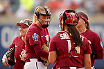 OKLAHOMA CITY, OK - JUNE 04: Meghan King #48 of the Florida State Seminoles shares a moment with her teammates against the Washington Huskies during the Division I Women's Softball Championship held at USA Softball Hall of Fame Stadium - OGE Energy Field on June 4, 2018 in Oklahoma City, Oklahoma. (Photo by Shane Bevel/NCAA Photos via Getty Images)