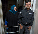 Annoud Mohamad Ali (left) participated in a sewing course conducted by RNVDO in Mosul, Iraq, which has helped her to earn income for her family. Here she stands in the doorway of her home with her husband, Yousif Yahya.<br /> <br /> The class was supported by the ACT Alliance.<br /> <br /> No social media use.