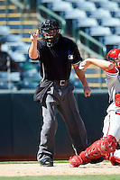 Umpire Nick Bailey makes a call during an Arizona Fall League game between the Phoenix Desert Dogs and Peoria Javelinas at Phoenix Municipal Stadium on October 12, 2012 in Phoenix, Arizona.  Phoenix defeated Peoria 13-3.  (Mike Janes/Four Seam Images)