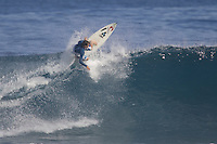 Former World Professional surfing champion, Californian, Tom Curren (USA) practices for the Rip Curl Search World Champion Tour (WCT) event at the surf break of St Leu on Reunion Island today June 21st 2005. Photo: Joli
