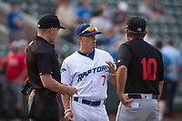 Ogden Raptors manager Jeremy Rodriguez (7) meets with Great Falls Voyagers manager Tim Esmay (10) and home plate umpire Bobby Tassone before a Pioneer League game against the Great Falls Voyagers at Lindquist Field on August 23, 2018 in Ogden, Utah. The Ogden Raptors defeated the Great Falls Voyagers by a score of 8-7. (Zachary Lucy/Four Seam Images)