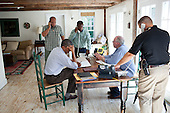 "Aug. 26, 2011.""A former President once said, 'Presidents don't get vacations, they just get a change of scenery.'  We were on 'vacation' in Martha's Vineyard and the President was monitoring Hurricane Irene with John Brennan, Assistant to the President for Homeland Security and Counterterrorism, at right in light blue shirt. They were waiting for a conference on the hurricane with affected governors and mayors."".Mandatory Credit: Pete Souza - White House via CNP"