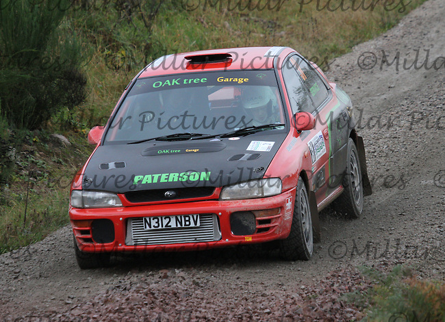 Stuart Paterson / Craig Service near Junction 5 on Special Stage 2 Jas P Wilson Forrest Machines Dalbeattie 1 of the Armstrong Galloway Hills Rally 2013, Round 9 of the RAC MSA Scotish Rally Championship sponsored by ARR Craib Transport Ltd which was organised by Solway, Machars and East Ayrshire Car Clubs and based in Castle Douglas on 27.10.13.