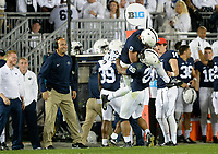 STATE COLLEGE, PA - OCTOBER 21:  Penn State head coach James Franklin smiles as QB Trace McSorley (9) and RB Saquon Barkley (26) celebrate on the side line after Barkley caught a touchdown pass, fro his third touchdown of the game. The Penn State Nittany Lions defeated the Michigan Wolverines 42-13 on October 21, 2017 at Beaver Stadium in State College, PA. (Photo by Randy Litzinger/Icon Sportswire)