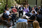 """May 19, 2012.""""One of the great things about the G8 Summit being at Camp David was the relaxed and casual atmosphere. When the President decided to have a unscheduled meeting with just the Eurozone leaders, he asked them to step outside on the Laurel Cabin patio where the leaders and their staff all pulled up chairs for the impromptu meeting."""" .Mandatory Credit: Pete Souza - White House via CNP"""