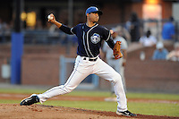 Asheville Tourists pitcher Peter Tago #26 delivers a pitch against the Rome Braves at McCormick Field on August 18, 2011 in Asheville, North Carolina. Rome won the game 12-11.   (Tony Farlow/Four Seam Images)