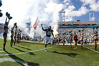 November 08, 2009:    Jacksonville Jaguars wide receiver Ernest Wilford (85) runs on the field carrying an American Flag during Military Appreciation Day prior to the start of action  between the AFC West  Kansas City Chiefs and AFC South Jacksonville Jaguars at Jacksonville Municipal Stadium in Jacksonville, Florida............