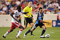 Arturo Alvarez (10) of the San Jose Earthquakes is chased by Tony Tchani (23) of the New York Red Bulls. The New York Red Bulls defeated the San Jose Earthquakes 2-0 during a Major League Soccer (MLS) match at Red Bull Arena in Harrison, NJ, on August 28, 2010.