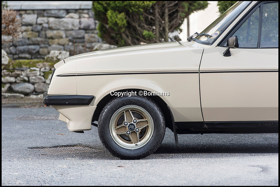 BNPS.co.uk (01202 558833)Pic: Bonhams/BNPS<br /> <br /> A 38-year-old Ford Escort with just 30,000 on the clock has emerged for sale for an eye-watering £40,000.<br /> <br /> The beige RS2000 was built in 1980 and is the racing version of Ford's mark two Escort which was released in 1974.<br /> <br /> It has had just three owners since new, with its current owner, a renowned Ford collector owning the saloon since 2016.<br /> <br /> Previously it had been in the same ownership since 1981, during which time is was perfectly maintained and looked after.