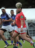 Fa'atonu Fili passes during the Village Kings 10s rugby tournament  match between Aiga Malisi (red) and Wellington Samoan at Porirua Park in Porirua, New Zealand on Saturday, 21 October 2017. Photo: Dave Lintott / lintottphoto.co.nz