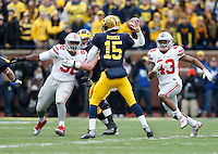 Ohio State Buckeyes defensive lineman Adolphus Washington (92) and linebacker Darron Lee (43) pursue Michigan Wolverines quarterback Jake Rudock (15) during the NCAA football game at Michigan Stadium in Ann Arbor on Nov. 28, 2015. Ohio State won 42-13. (Adam Cairns / The Columbus Dispatch)