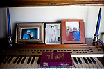 "Photos of Will Langdon and his wife, Naomi, who has passed away sit in the living room..Will has lived in Sun City since it opened in 1960. This year is Sun City's 50th anniversary..When he first came to Sun City with his wife the area was surrounded by cotton fields. His house was one of the first built in Sun City. Before he had a wall in his backyard, he and his neighbors would gather on Sundays. ""We would gather and bring all the tables and food out. It was ver nice, but times change and people die,"" he said..His home is filled with John Wayne and other western memorabilia. ""John Wayne is my heo. He exemplifies what every man should do and be,"" he said..Will's wife Naomi has since passed away and he is recovering from prostate cancer. He has outlived his friends, as well. ""I'm what you call the last of the Mohicans and I'm holding on."""