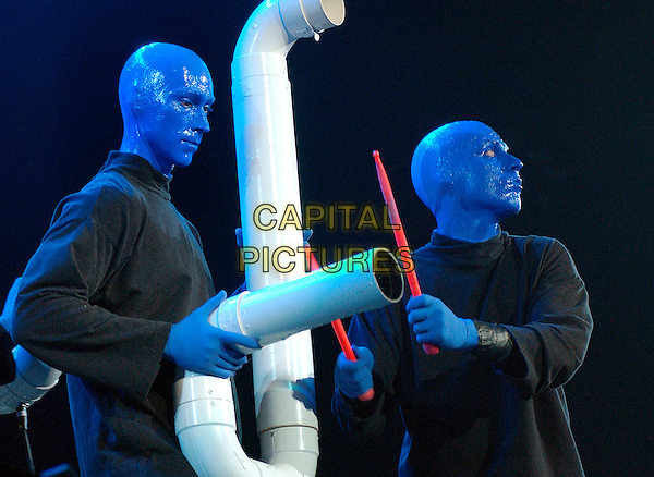 "BLUE MAN GROUP.Experimental musical theatre troupe the BLUE MAN GROUP performs as a part of the ""How To Be a Megastar Tour 2.0""  held at the Mellon Arena, Pittsburgh, Pennsylvania, USA, 30 September 2006..half length on stage concert show performance performing pipes red spoons red drum sticks.Ref: ADM/JN.www.capitalpictures.com.sales@capitalpictures.com.©Jason L Nelson/AdMedia/Capital Pictures."